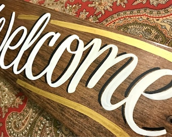 Welcome sign, handpainted on wood