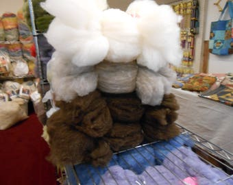 4, 4 oz. bundles of natural and natural dyed carded wool batts from our Corriedale sheep for felting, spinning and other fiber arts.