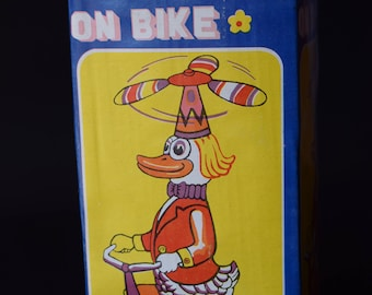 Windup Toy Duck on Bicycle
