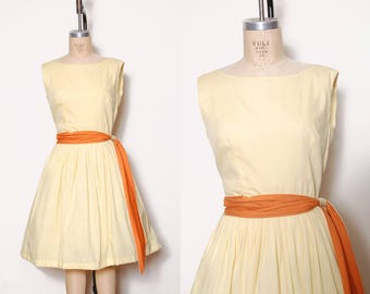 Vintage 50s yellow pleated dress / belted dress / fit and flare dress / 50s swing dress / pin up summer dress