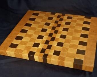 End grain cutting board with geometric design