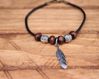 Leather bracelet with feather