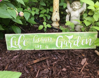 Life began in a garden wood sign