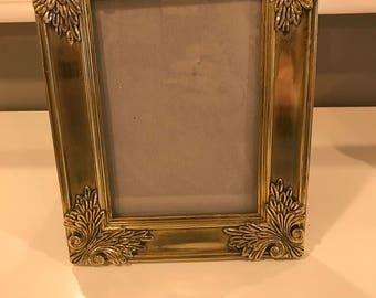 Detailed vintage gold color picture frame