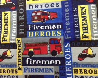 30 inches of flannel firemen theme on blue background cotton fabric
