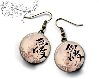 Japanese writing on the earrings under cabochon resin