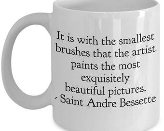 "Saint Quote Mug - St. Andre Bessette ""It is with the smallest brushes that the artist paints the ...beautiful pictures."" Ceramic Coffee Cup"