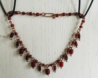 Copper necklace with red glass beads