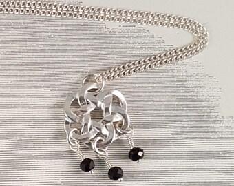 Black spinel sterling silver knot necklace