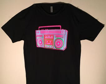 One of a kind only, mens size large. neon boombox in baby blue and neon mix on black polyblend t shirt