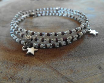Seed bracelet with charm asterisks
