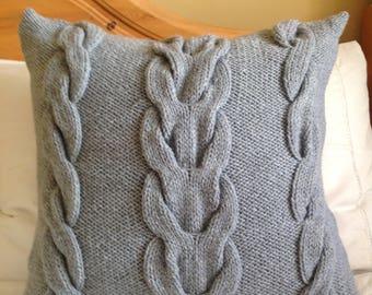 Hand knitted Aran cushion cover