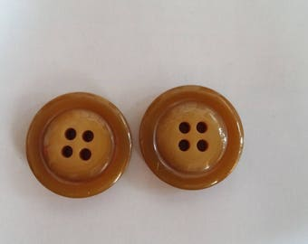 two large Brown buttons