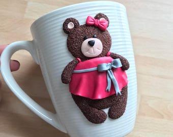 Ceramic mug with polymer clay decor.