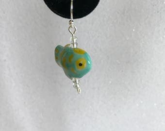 Cute ceramic aqua and spotted yellow fish dangle earrings accented with iridescent clear beads set in silver