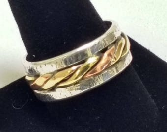 Twisted copper and brass and textured sterling silver ring