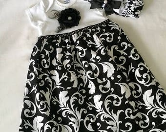 9-12 mo. Onesie dress ..Short sleeved black and white onesie dress with matching hat. Free Shipping