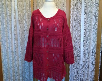 Very gently used, elegant lacework tunic in red. Size M.