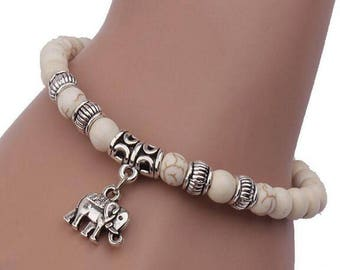 Elephant pendant bracelet White Bead and Silver Tone Design