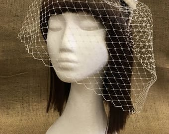 Hand beaded fascinator with veil