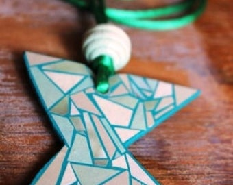 wooden necklace decorated with paper