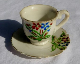 vintage child's miniature tea cup and saucer with flowers and gold trim