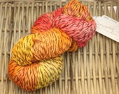 Sunset Twist - Worsted Weight Wool (100% Pure Virgin Wool) in bright red, orange, and yellow with a brown ply.
