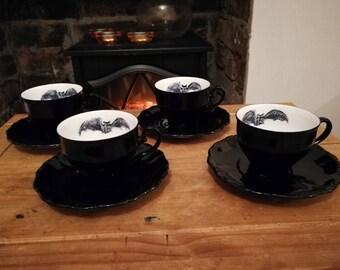 Batty teacups and saucers