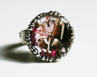 Resin ring with metal silver color with an illustration of sewing accessories