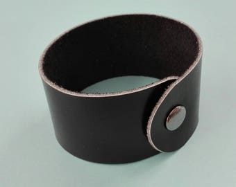 Various wide leather bracelets