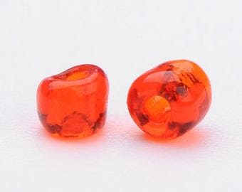lot 10g 12/0 seed beads: transparent red 2 mm