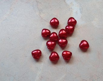 Red Pearlescent heart shaped acrylic beads.