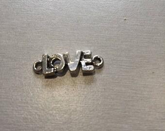 """silver metal """"love"""" connector"""