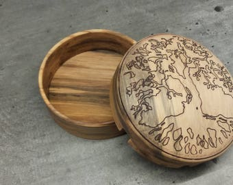 Engraved box with a tree motif