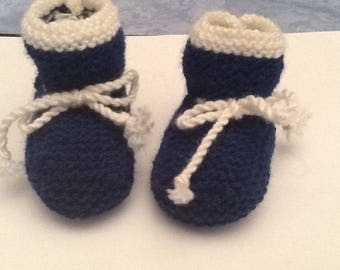 Knitted baby booties. Baby