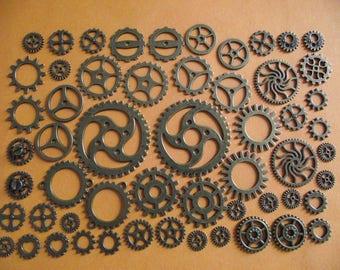 Set of 56 Charms Watch gears, bronze. 1 cm to 4 cm in diameter. (ref n 56)