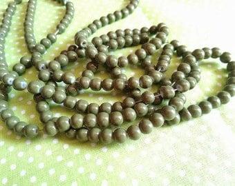6 mm / 25 glass beads 6 mm khaki