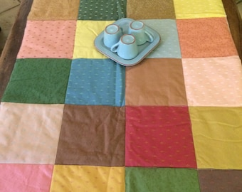 Squares of assembled fabric way patchwork table runner or tablecloth