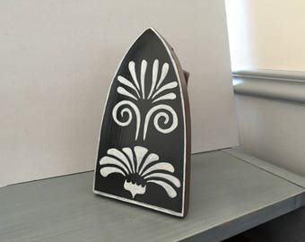 An original doorstop: this old iron restyled.
