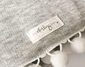 Grey baby blanket | pom pom trim blanket