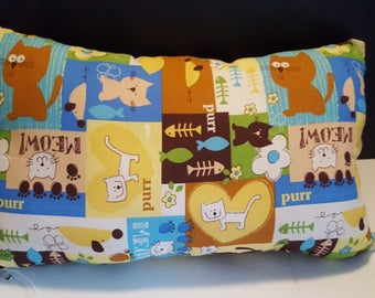 Cat pillow with all kinds of pretty little kitties on