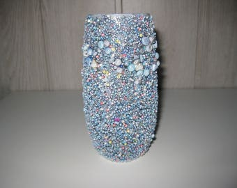 vase covered with seed beads