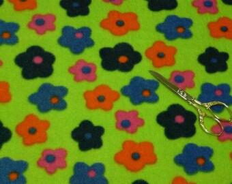 Fleece fabric lime green polka flowers