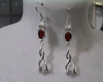 """""""Twisted Variations of silver and Topaz on garnets"""" earrings"""