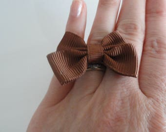ring with a Brown bow