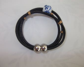 Black leather strap and glass bead
