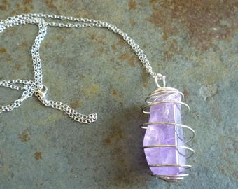 Necklace with pendant and amethyst in its cage