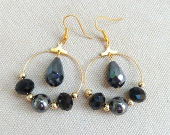 Black beads and gold hoop earrings