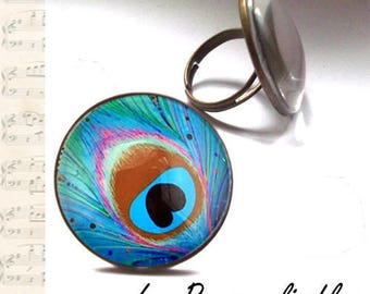 Peacock ring in bronze with glass dome.