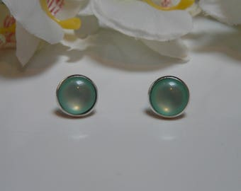 Earrings made with a Green 12mm glass cabochon